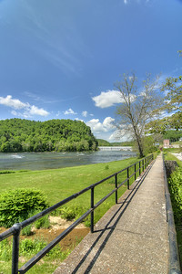 A walkway leads along the New River toward the dam in Fries, VA on Friday, May 31, 2013. Copyright 2013 Jason Barnette