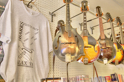 Various instruments for sale at the historic Barr's Fiddle Shop on Main Street in Galax, VA on Saturday, August 10, 2013. Copyright 2013 Jason Barnette