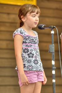 A young girl performs during the 78th Annual Old Fiddlers' Convention in Galax, VA on Saturday, August 10, 2013. Copyright 2013 Jason Barnette