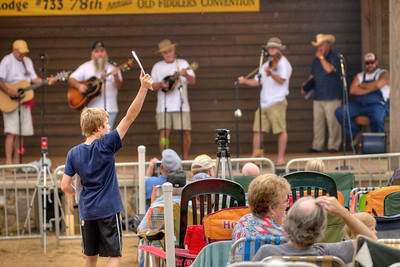A young boy sells programs during the 78th Annual Old Fiddlers' Convention in Galax, VA on Saturday, August 10, 2013. Copyright 2013 Jason Barnette