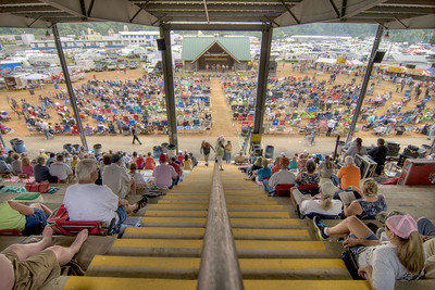 People watch the music performances under the roof of a covered sitting area during the 78th Annual Old Fiddlers' Convention in Galax, VA on Saturday, August 10, 2013. Copyright 2013 Jason Barnette