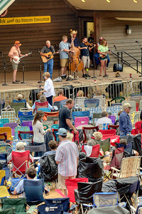 People sit in lawn chairs watching a band perform during the 78th Annual Old Fiddlers' Convention in Galax, VA on Saturday, August 10, 2013. Copyright 2013 Jason Barnette