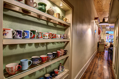 Patrons who order a beverage and sit at a table get the chance to pick their own mug from this collection on a wall at Central Cafe at the Town Square in Glade Spring, VA on Saturday, December 14, 2013. Copyright 2013 Jason Barnette  Central Cafe opened in November 2013, owned by locals Ann and David Ledgerwood. The cafe offers cold cut sandwiches, soups and pastas, coffee, tea, and deserts.