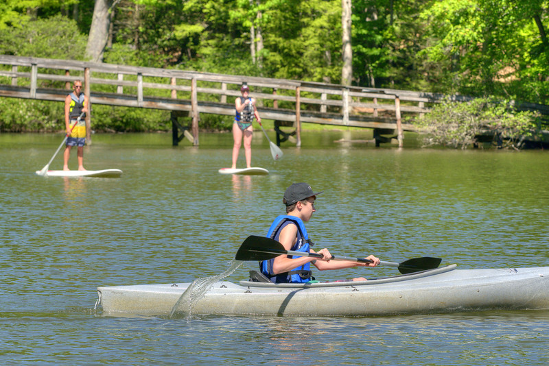 A young boy takes a kayak out on the lake at Hungry Mother State Park in Marion, VA on Saturday, May 24, 2014. Copyright 2014 Jason Barnette