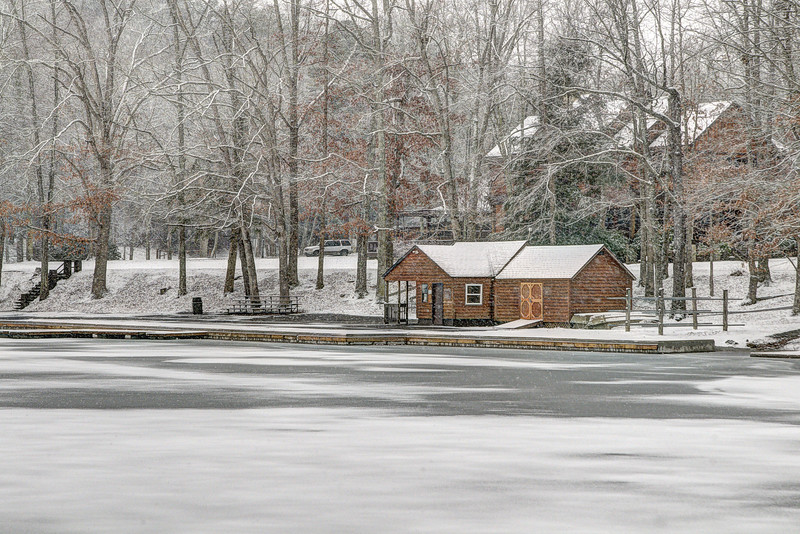 The boat house, bustling with the business of canoes and kayaks during the warm summer months, surrounded by a frozen lake and fresh snow at Hungry Mother State Park in Marion, VA on Tuesday, January 21, 2014. Copyright 2014 Jason Barnette
