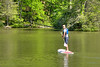 A teenage man takes a paddleboard out on the lake at Hungry Mother State Park in Marion, VA on Saturday, May 24, 2014. Copyright 2014 Jason Barnette