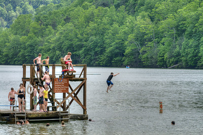 People dive into the lake at Hungry Mother State Park in Marion, VA on Saturday, June 1, 2013. Copyright 2013 Jason Barnette