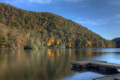 Fall colors highlight a few trees across the still waters of the lake at Hungry Mother State Park in Marion, VA on Sunday, October 19, 2014. Copyright 2014 Jason Barnette