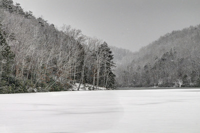The frozen lake covered with a fresh snow at Hungry Mother State Park in Marion, VA on Tuesday, January 21, 2014. Copyright 2014 Jason Barnette