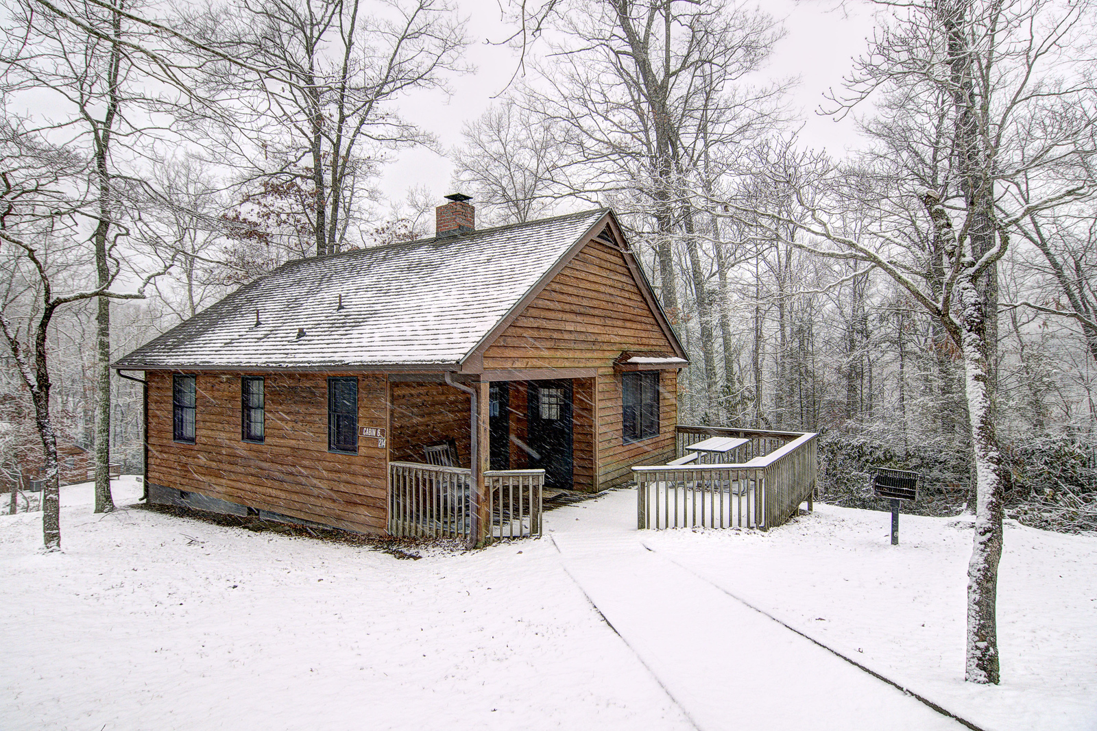 Snow Covers A Rental Cabin At Hungry Mother State Park In Marion, VA On  Tuesday