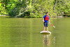 A young boy stands tall on a paddleboard on the lake at Hungry Mother State Park in Marion, VA on Saturday, May 24, 2014. Copyright 2014 Jason Barnette