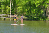 A couple enjoy paddleboarding on the lake at Hungry Mother State Park in Marion, VA on Saturday, May 24, 2014. Copyright 2014 Jason Barnette