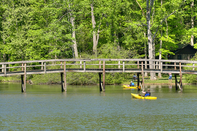 People ride their kayaks under the footbridge at Hungry Mother State Park in Marion, VA on Saturday, May 24, 2014. Copyright 2014 Jason Barnette