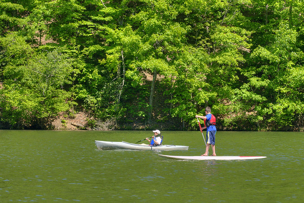 People enjoy paddleboarding and kayaking on the lake at Hungry Mother State Park in Marion, VA on Saturday, May 24, 2014. Copyright 2014 Jason Barnette