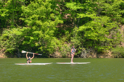 A young man falls from his paddleboard on the lake at Hungry Mother State Park in Marion, VA on Saturday, May 24, 2014. Copyright 2014 Jason Barnette