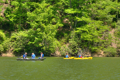 People ride the lake in a small motorized boat and a pair of kayaks at Hungry Mother State Park in Marion, VA on Saturday, May 24, 2014. Copyright 2014 Jason Barnette