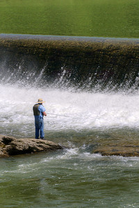 A man fishes on the New River near a dam along Highway 58 just outside Independence, VA on Friday, May 31, 2013. Copyright 2013 Jason Barnette