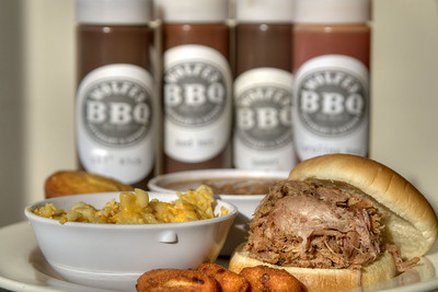 The BBQ Platter along with the four sauces made fresh in-house, Lil' Kick, Red Hot, Sweet, and Carolina Red, at Wolfe's BBQ Restaurant & Catering  on Main Street in Marion, VA on Tuesday, August 6, 2013. Copyright 2013 Jason Barnette