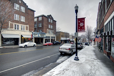 A fresh snow covers the sidewalk along Main Street in Marion, VA on Tuesday, January 21, 2014. Copyright 2014 Jason Barnette