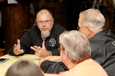 Owner Scott Schumaker answers initial questions during Still Nights, an event where participants enjoy dinner at the Mercantile on Main Street before heading out of town to the distillery to learn about the art and craft of making moonshine and whisky, in Marion, VA on Saturday, September 13, 2014. Copyright 2014 Jason Barnette