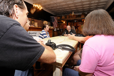 Participants chat with owner SCott Schumaker during Still Nights, an event where participants enjoy dinner at the Mercantile on Main Street before heading out of town to the distillery to learn about the art and craft of making moonshine and whisky, in Marion, VA on Saturday, September 13, 2014. Copyright 2014 Jason Barnette