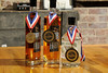 The Virginia Sweetwater Moonshine, winner of a Gold Award at the Great American Distiller's Festival, and two bottles of the War Horn Whisky, winners of Gold Award at the Great American Distiller's Festival and Bronze Award at the American Distilling Institute Conference, sitting on the Tasting Room bar at Appalachian Mountain Spirits on Main Street in Marion, VA on Wednesday, April 16, 2014. Copyright 2014 Jason Barnette