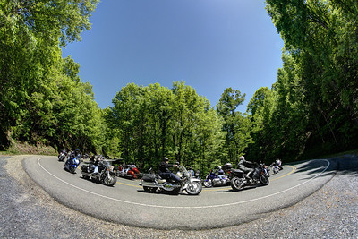 Motorcyclists ride The Back of the Dragon between Marion and Tazewell, this photo taken in Marion, VA on Saturday, May 24, 2014. Copyright 2014 Jason Barnette - Photo Image  I wanted to capture a single photo that showed just how many motorcyclists ride The Back of the Dragon on a beautiful summer day. However, I realized even if I sat there all day and capture a single photo of an enormous single group of riders, it would still not convey just how many ride the route daily. So I decided to capture a series of approximately 100 photos over the course of an hour and created this composite image. All these photos were taken on the same day during a single hour while the sun was in the best position.
