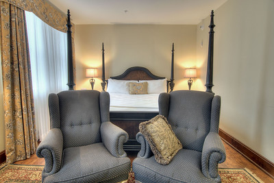 A four-poster bed and a pair of high-back chairs inside the Junior King Bedroom at the General Francis Marion Hotel, locally-owned and completely renovated in 2004, in Marion, VA on Wednesday, August 7, 2013. Copyright 2013 Jason Barnette
