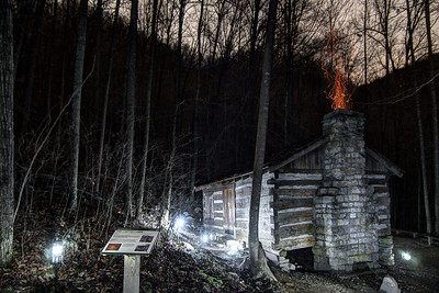 Fire sparks erupt from the chimney of the Carter Cabin during the Lighting of the Tunnel at Natural Tunnel State Park in Duffield, VA on Friday, December 13, 2013. Copyright 2013 Jason Barnette  The Lighting of the Tunnel is part of the annual 8 Days of Christmas event at Natural Tunnel State Park. The event includes thousands of lights from the main entrance to the top of the chair lift, rides on the chair lift to the bottom, lights decorating the walkways and tunnel, bonfires, marshmallows, music, and appearances by Santa Claus.