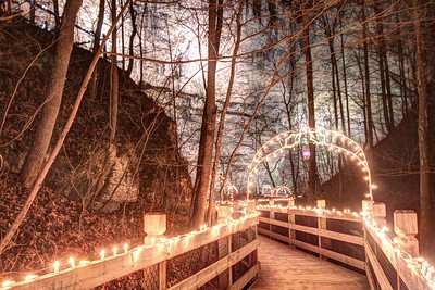 Holiday lights decorated the wooden boardwalk during the Lighting of the Tunnel at Natural Tunnel State Park in Duffield, VA on Friday, December 13, 2013. Copyright 2013 Jason Barnette  The Lighting of the Tunnel is part of the annual 8 Days of Christmas event at Natural Tunnel State Park. The event includes thousands of lights from the main entrance to the top of the chair lift, rides on the chair lift to the bottom, lights decorating the walkways and tunnel, bonfires, marshmallows, music, and appearances by Santa Claus.