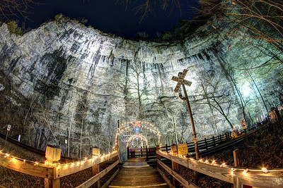 The boardwalk was decorated with holiday lights and the massive cliff lit by lights during the Lighting of the Tunnel at Natural Tunnel State Park in Duffield, VA on Friday, December 13, 2013. Copyright 2013 Jason Barnette  The Lighting of the Tunnel is part of the annual 8 Days of Christmas event at Natural Tunnel State Park. The event includes thousands of lights from the main entrance to the top of the chair lift, rides on the chair lift to the bottom, lights decorating the walkways and tunnel, bonfires, marshmallows, music, and appearances by Santa Claus.