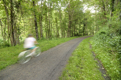 A woman rides her bicycle along New River Trail State Park in Galax, VA on Thursday, May 30, 2013. Copyright 2013 Jason Barnette