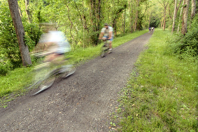 People ride bicycles and jog along New River Trail State Park in Galax, VA on Thursday, May 30, 2013. Copyright 2013 Jason Barnette