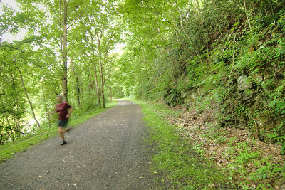 A man takes a jog along New River Trail State Park in Galax, VA on Thursday, May 30, 2013. Copyright 2013 Jason Barnette