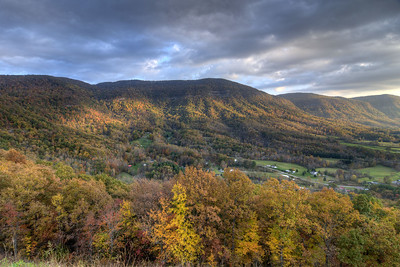A beam of sunlight splashes across the fall colors at the Powell Valley Overlook on Highway 23 in Norton, VA on Saturday, October 25, 2014. Copyright 2014 Jason Barnette
