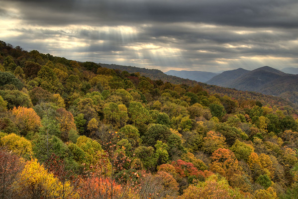 Beams of light break through the clouds over brilliant fall colors at the Flag Rock Recreation Area in Norton, VA on Saturday, October 25, 2014. Copyright 2014 Jason Barnette