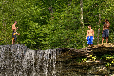 A group of young men stand on top of Cascade Falls Recreation Area in Pembroke, VA on Wednesday, July 30, 2014. Copyright 2014 Jason Barnette  Cascade Falls is a 66' waterfall location at the end of a 4-mile loop hiking trail through fairly rough terrain in a dense forest. It is managed by the National Forest Service and the recreation area includes a paved parking lot (day-use only, fee required), a picnic area, and a restroom facility.