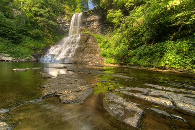 Sitting at the edge of the pool at the bast of Cascade Falls Recreation Area in Pembroke, VA on Wednesday, July 30, 2014. Copyright 2014 Jason Barnette  Cascade Falls is a 66' waterfall location at the end of a 4-mile loop hiking trail through fairly rough terrain in a dense forest. It is managed by the National Forest Service and the recreation area includes a paved parking lot (day-use only, fee required), a picnic area, and a restroom facility.