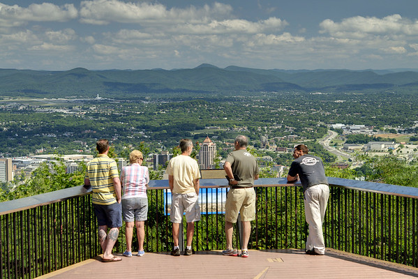 People admire the downtown city view from the Mill Mountain Overlook high above Roanoke, VA on Friday, July 4, 2014. Copyright 2014 Jason Barnette