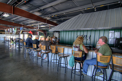 People enjoy an early afternoon beer at Soaring Ridge Brewery, craftily constructed inside an old Sunbeam Bread distribution facility, on Shenandoah Avenue in Roanoke, VA on Friday, July 4, 2014. Copyright 2014 Jason Barnette