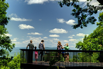 A group enjoys the view from the lower Mill Mountain Overlook in Roanoke, VA on Friday, July 4, 2014. Copyright 2014 Jason Barnette