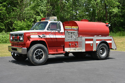 Rockingham County, Virginia Tanker 90 operates from the East Rockingham Emergency Services station in McGaheysville.  This is a 1979 GMC 7000/1991 Keplinger Repair/1984 4-Guys with a 250/1350.  It was originally delivered to Bergton, Virginia (also in Rockingham County) as Tanker 58.  The 1979 GMC was originally an ex- used truck from a truck dealer.  It was joined to a 1984 4-Guys tanker body that came Capon Bridge, West Virginia.  While at Capon Bridge, this tanker body was on a 1963 Ford C.  Bergton, Virginia donated this tanker to Rockingham County in 2013.