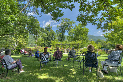 People enjoy live music during a special lunch event at the Southwest Virginia Museum Historical State Park in Big Stone Gap, VA on Friday, July 26, 2013. Copyright 2013 Jason Barnette