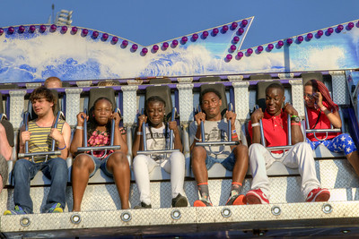 People enjoy the carnival rides during the Salem Fair at the Salem Civic Center in Salem, VA on Friday, July 4, 2014. Copyright 2014 Jason Barnette