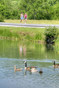 Two women walk along Lake Drive in Saltville, VA on Tuesday, June 4, 2013. Copyright 2013 Jason Barnette
