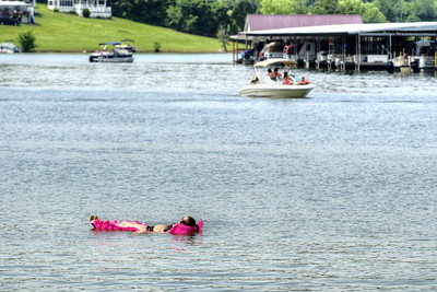 A woman floats in the water at Observation Knob Park on South Holston Lake near Bristol, TN on Sunday, June 9, 2013. Copyright 2013 Jason Barnette