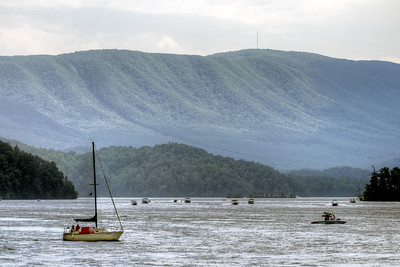 Boats move along South Holston Lake near Bristol, TN on Sunday, June 9, 2013. Copyright 2013 Jason Barnette