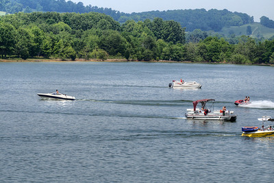 Boats ride along South Holston Lake near Bristol, TN on Sunday, June 9, 2013. Copyright 2013 Jason Barnette