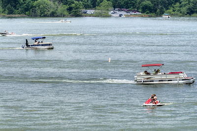 Boats and jet skis jet along South Holston Lake near Bristol, TN on Sunday, June 9, 2013. Copyright 2013 Jason Barnette