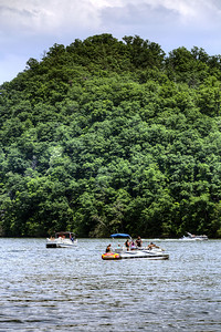 Boats linger on South Holston Lake near Bristol, TN on Sunday, June 9, 2013. Copyright 2013 Jason Barnette